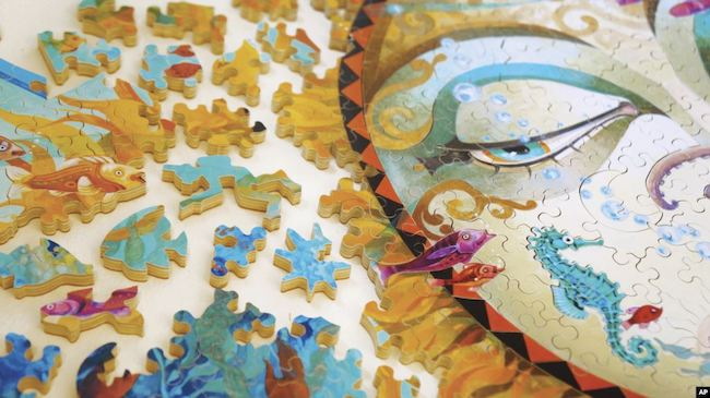 A colourful jigsaw puzzle, image by David Galchutt, Stave Puzzles